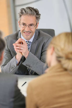 clients: Consultant listening to clients in meeting