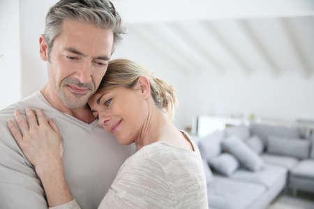 feeling good: Mature man embracing wife and feeling good Stock Photo