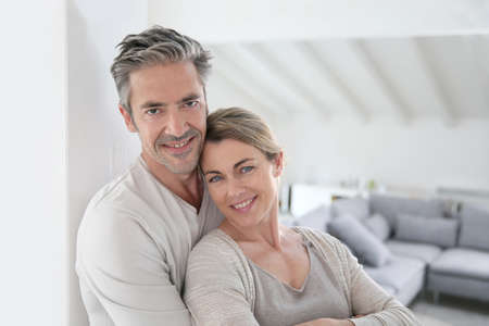 textspace: Portrait of mature couple relaxing at home Stock Photo