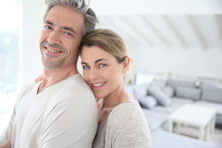 Happy mature couple in brand new home Stock Photo