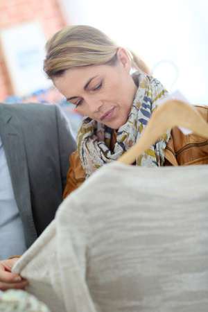 clothing store: Mature couple shopping in clothing store Stock Photo