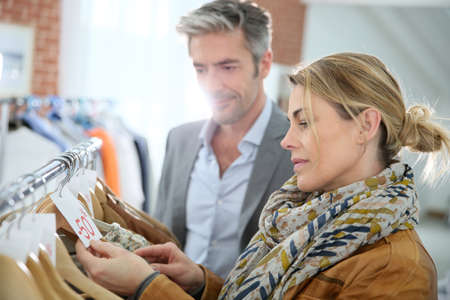 Mature couple shopping in clothing store photo