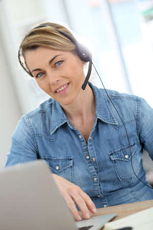 teleworking: Active woman teleworking from home Stock Photo