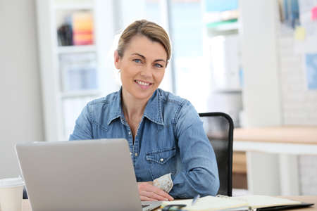 mature business: Businesswoman working from home on laptop