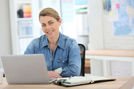working from home: Businesswoman working from home on laptop