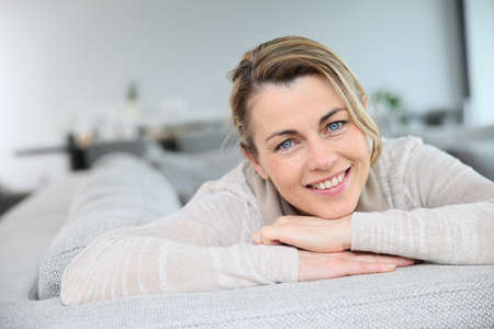 Portrait of mature smiling blond woman photo