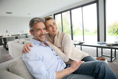 Portrait of mature couple relaxing at home Stock Photo - 39074262