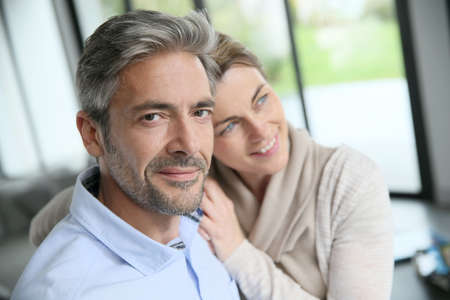 old sofa: Portrait of mature couple relaxing at home Stock Photo
