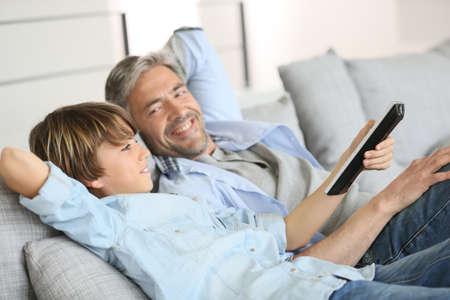 dad: Father and son watching tv together