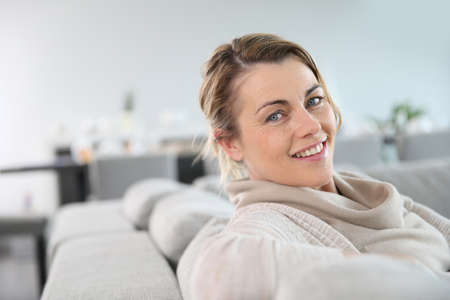 old sofa: Portrait of mature woman relaxing in sofa