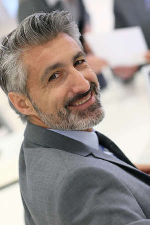 mature businessman: Portrait of mature businessman with grey hair