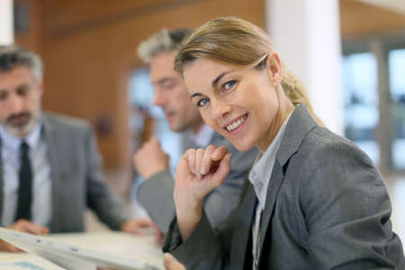 Portrait of executive woman in business meeting Stock Photo