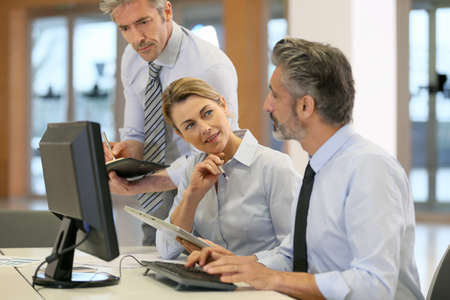 Business team working on project in office Stock Photo