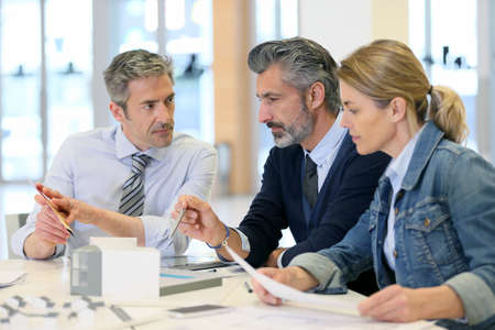 workteam: Team of architects working on construction project Stock Photo