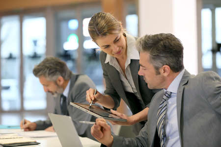 workteam: Business partners working together in office Stock Photo