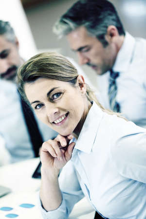 workteam: Smiling businesswoman attending work meeting