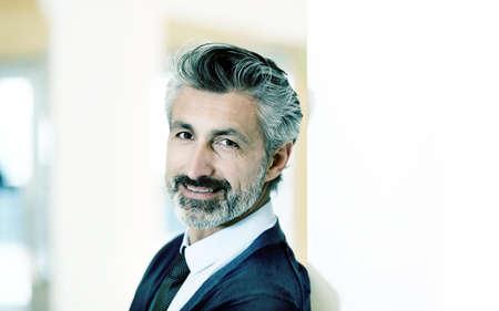 Portrait of confident mature businessman photo