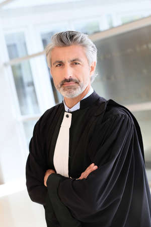 solicitor: Portrait of lawyer standing in courthouse corrridor Stock Photo