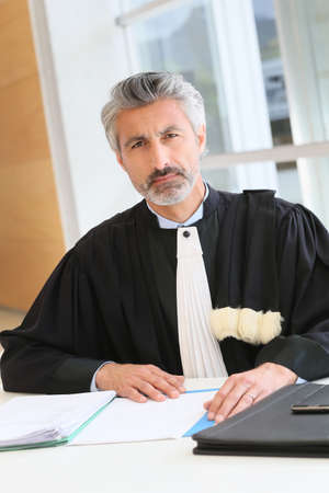 Mature lawyer working on judgement report photo