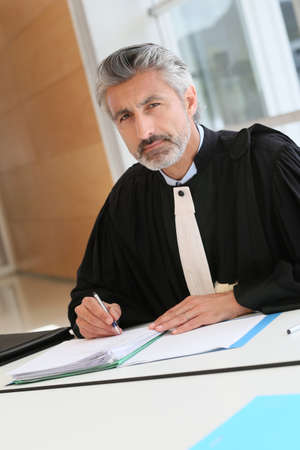 solicitor: Mature lawyer working on judgement report