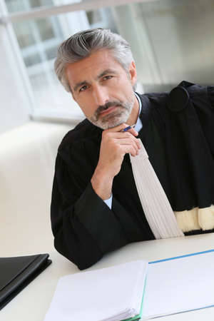 counsel: Mature lawyer working on judgement report