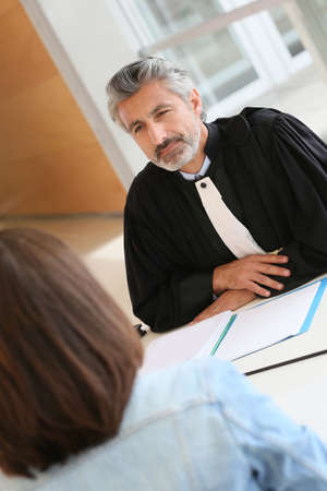 Lawyer meeting client in courthouse office photo