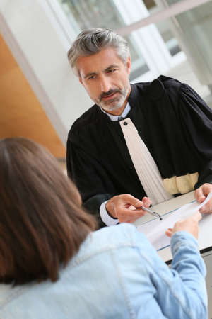 lawyer meeting: Lawyer meeting client in courthouse office
