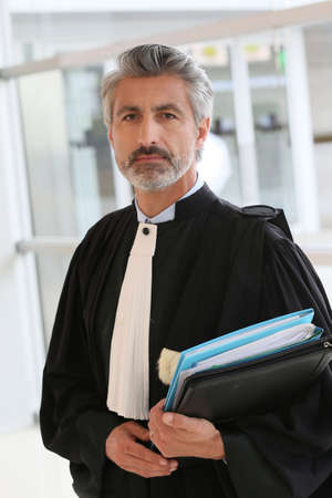 Portrait of lawyer standing in courthouse corrridor Stock Photo