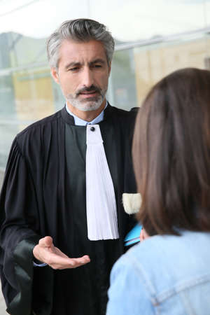 Lawyer meeting client in courthouse before trial Stock Photo