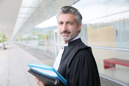 lawyer in court: Portrait of lawyer standing outside courthouse building
