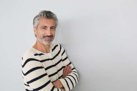 Portrait of handsome mature man on white background photo