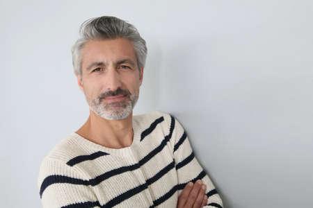 men standing: Portrait of handsome mature man on white background