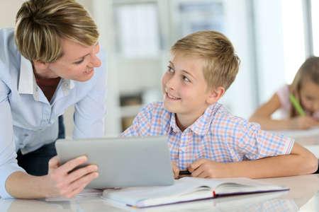 Teacher using digital tablet as educational tool in class photo