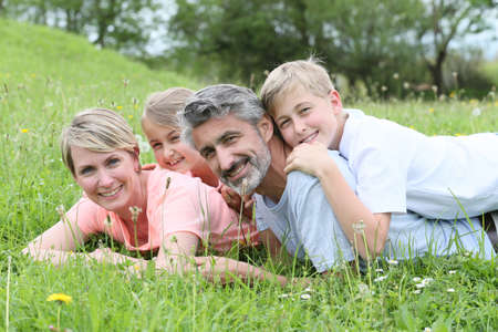 laying down: Portrait of family laying down in grass Stock Photo