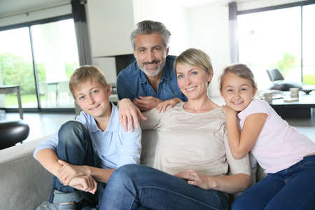 european people: Happy family in contemporary house