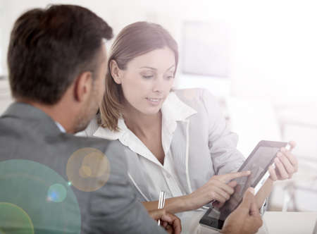 loans: Young woman presenting business plan to financial investor Stock Photo
