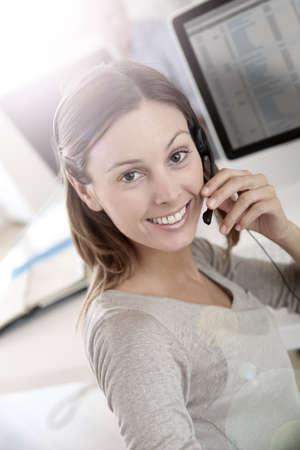 teleoperator: Beautiful smiling teleoperator with headset on Stock Photo