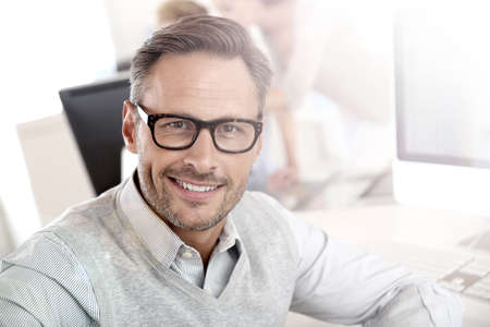 40 years old man: Portrait of smiling businessman with eyeglasses