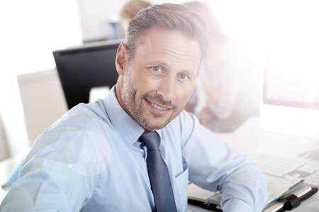 Handsome businessman sitting in office photo