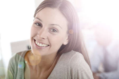 Smiling young woman in office photo