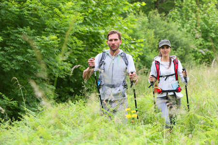 backpackers: Backpackers on a hiking journey Stock Photo