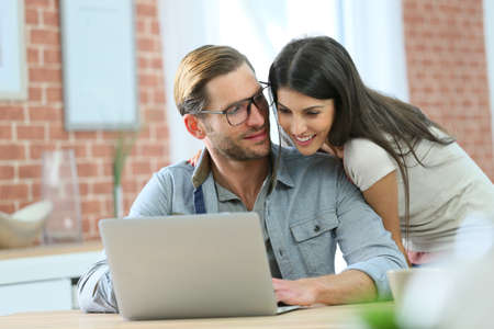 websurfing: Couple at home websurfing on laptop computer Stock Photo