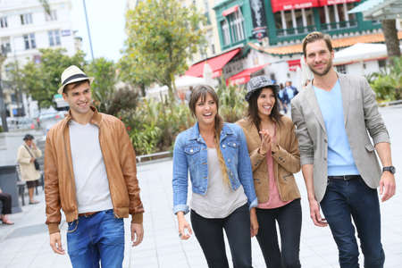 group of friends: Group of friends walking in street and having fun Stock Photo