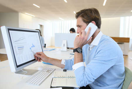 phonecall: Bank trader negotiating on the phone from office