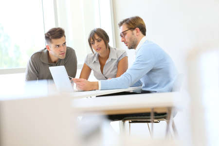 Business people working together in meeting room Foto de archivo
