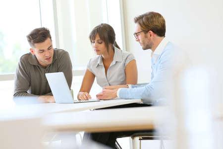 Business people working together in meeting room Banco de Imagens