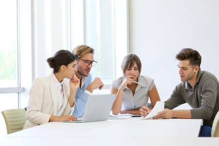 working group: Business people meeting around table in modern space Stock Photo