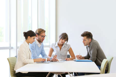 Business people meeting around table in modern space Banque d'images