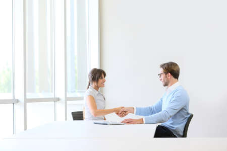 Businessman receiving candidate on job interview Stock Photo