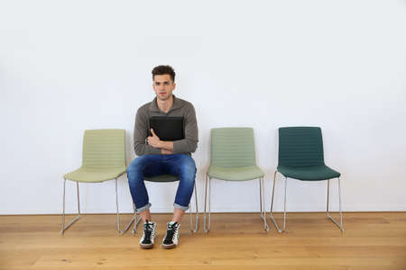 waiting posture: Young man in waiting room for job interview